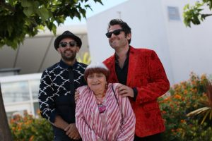 Matthieu Chedid (R), Agnes Varda and JR (L) attend the 'Faces, Places (Visages, Villages)' photocall during the 70th annual Cannes Festival at Palais des Festivals on May 19, 2017 in Cannes, France. / Shutterstock.com